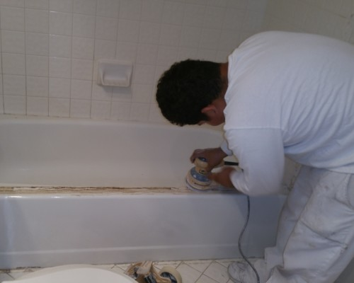 Sanding during a bathtub refinishing process by America Refinishing Pros