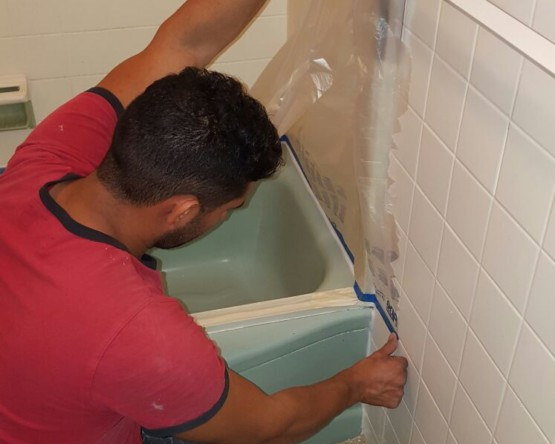 masking of surrounding areas during a bathtub refinishing process by America Refinishing Pros